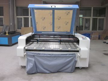 चीन Laser Fabric Cutter CO2 Laser Cutting Engraving Machine , Laser Power 100W वितरक